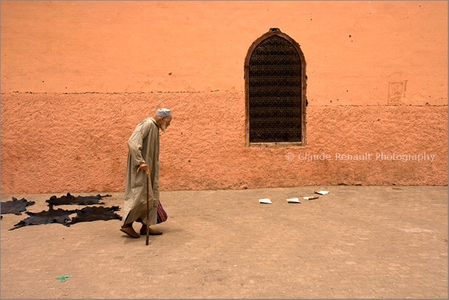 Walking by a mosque in Marakkech. Morocco. http://www.clauderenault.fr