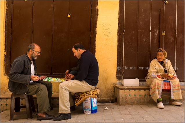 Playing chess in a street of Fez.