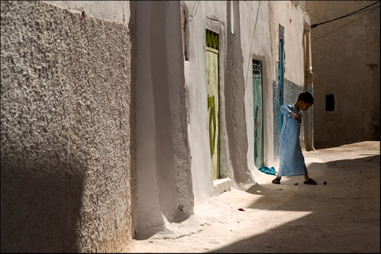 Playing in a street of Bahlil. Morocco.